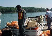 Inmates help clean Lake James in Big Sweep 2003