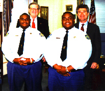Franklin Freeman and Mack Jarvis with twins Elton and Shelton Rogers, correctional officers at Franklin C.C.